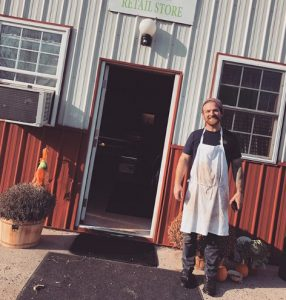 Butcher, Doug Palmer in front of SFM store