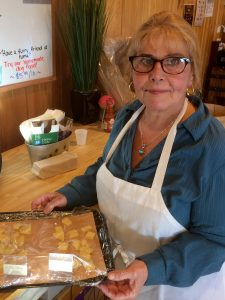 Denise serving cheese samples at Skillman Farm Market and Butcher Shop
