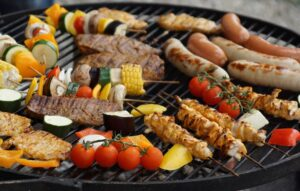 grill filled with meats and vegetables